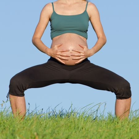 pregnant blonde: beautiful pregnant woman practicing yoga on a meadow