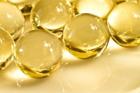 vitamin d: close up of vitamin oil capsules