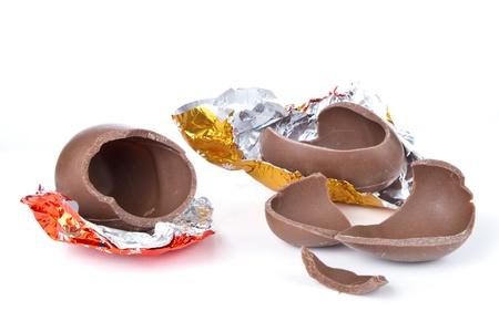 cracked chocolate egg isolated on white
