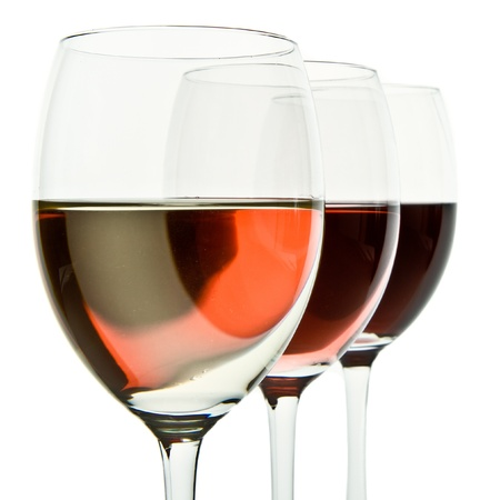 three glasses with white, rose and red wine Stock Photo - 10727085