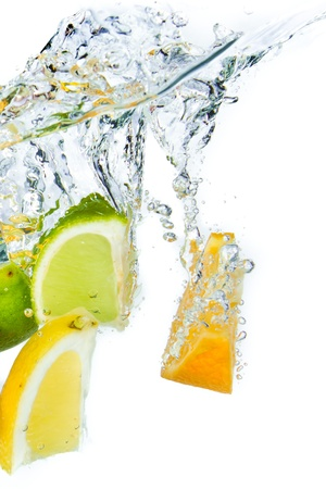 citrus fruit splashing isolated on white background Stock Photo