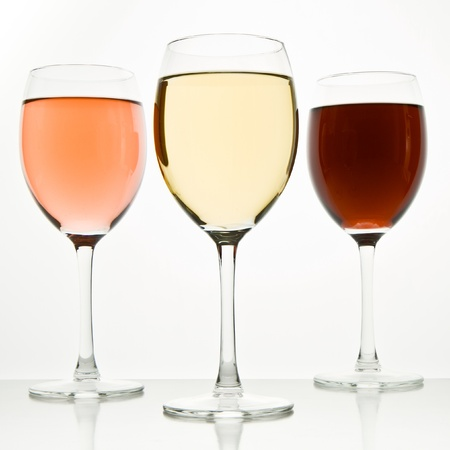 white wine glass: three glasses with white, rose and red wine