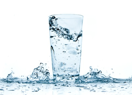 water glass: water splashing from glass isolated on white background
