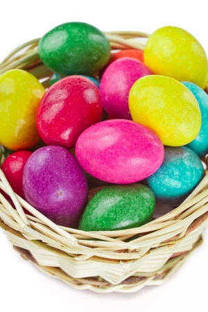 closeup of colorful easter eggs in basket isolated photo