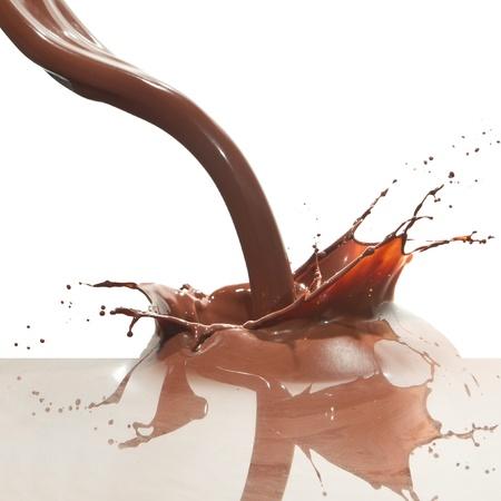 splash of chocolate isolated on white background photo