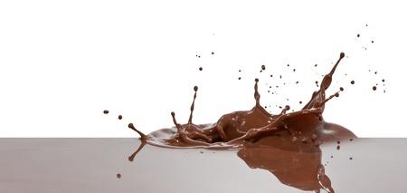 chocolate with milk: chocolate splash closeup isolated on white background Stock Photo