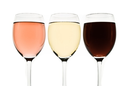 wineglasses: three glasses with white, rose and red wine