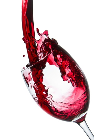 bordeaux: red wine pouring into wine glass isolated Stock Photo