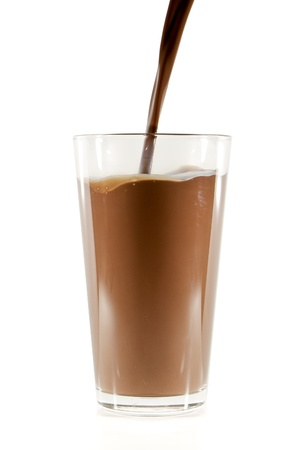 milk chocolate: pouring chocolate milk into the glass isolated on white