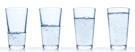 filled: set of glasses filled with water on white background