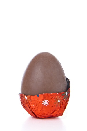 partly: partly unwrapped chocolated easter egg isolated