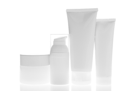 product placement: set of cosmetic bottles isolated on white background