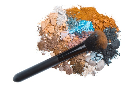 crushed eyeshadows with brush isolated on white background photo
