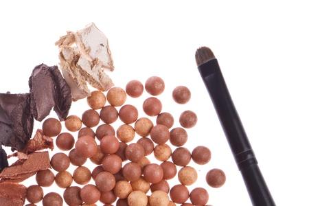 bronzing pearls and cream eyeshadows with brush isolated on white background Stock Photo - 12306616