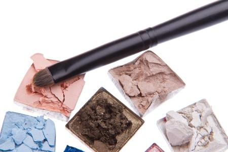 multicolored crushed eyeshadows with brush isolated on white background Stock Photo - 12306631