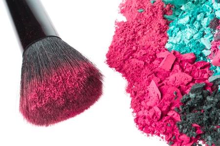 crushed eyeshadows with brush isolated on white background