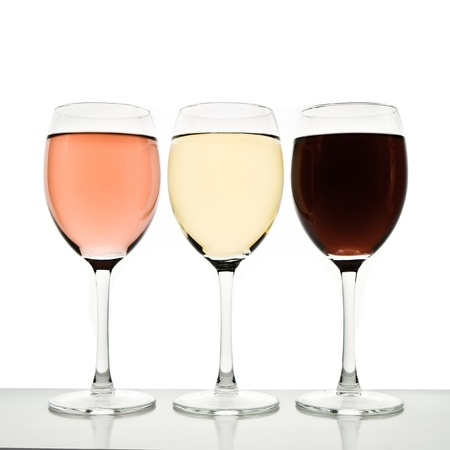 three glasses with white, rose and red wine Stock Photo - 12396649