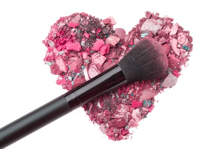 cosmetic products: heart shaped crushed eyeshadows with brush