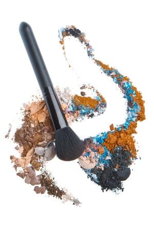 crushed eyeshadows mixed with brush isolated on white background Stock Photo - 12650441