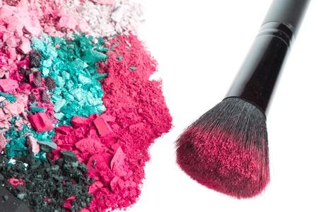 crushed eyeshadows with brush isolated on white background Stock Photo - 12639195