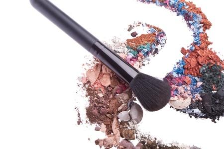 crushed eyeshadows mixed with brush isolated on white background Stock Photo - 12653499