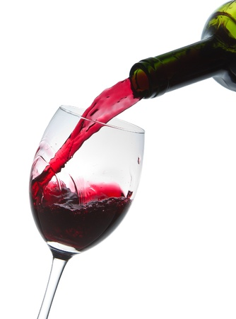 red taste: red wine pouring into wine glass isolated Stock Photo