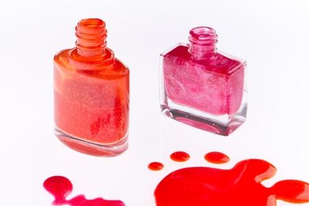 perfumery concept: spilled nail polish isolated on white background