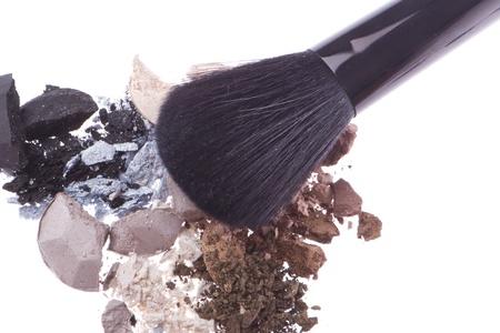 crushed eyeshadows with brush isolated on white background Stock Photo - 12809236