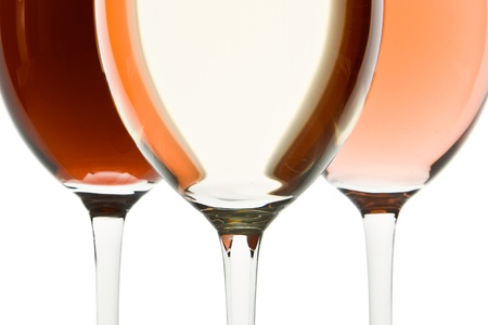 three glasses with white, rose and red wine photo
