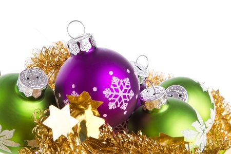 christmas balls with tinsel isolated on white background photo