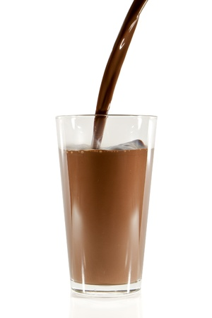 chocolate with milk: pouring chocolate milk into the glass isolated on white