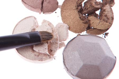 multicolored crushed eyeshadows with brush isolated on white background Stock Photo - 13098133