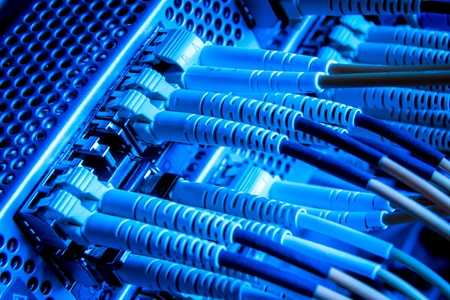 optic fiber cables connected to hub Stock Photo