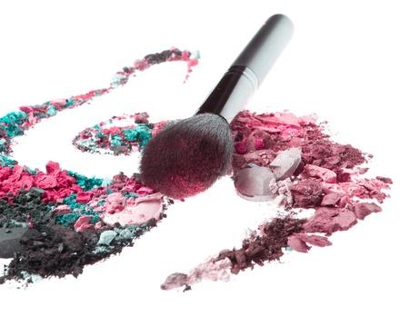 eyemakeup: crushed eyeshadows mixed with brush isolated on white background Stock Photo