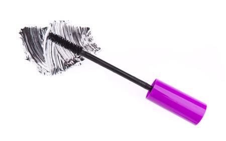 black mascara stroke isolated on white background photo