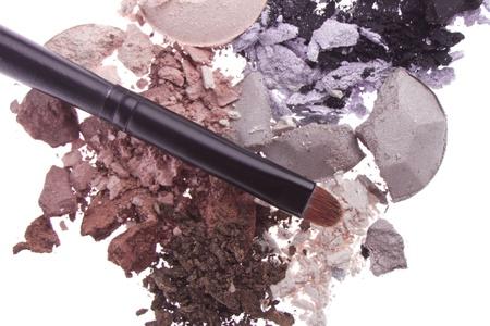crushed eyeshadows with brush isolated on white background Stock Photo - 13275174
