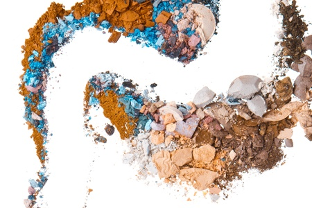 crushed eyeshadows mixed with brush isolated on white background photo