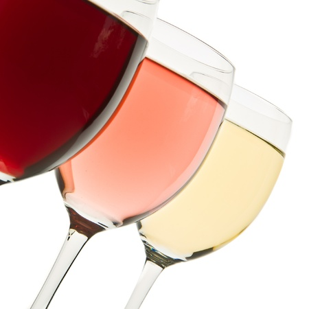 three glasses with white, rose and red wine Stock Photo - 13729811