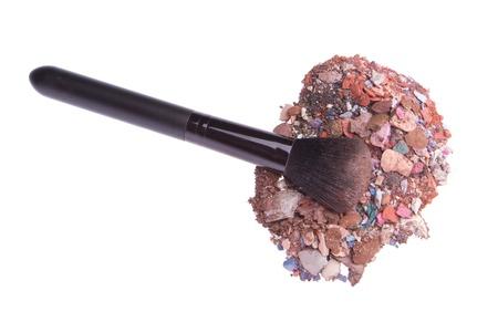mixed eyeshadows with brush isolated on white background photo