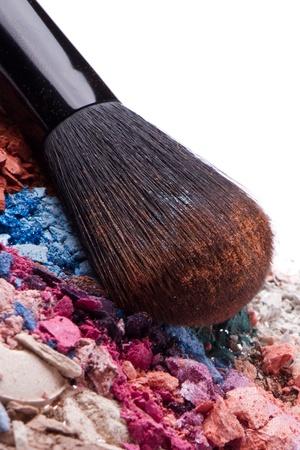 crushed eyeshadows with brush isolated on white background Stock Photo - 13730258