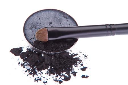 eyemakeup: crushed eyeshadow with brush isolated on white background