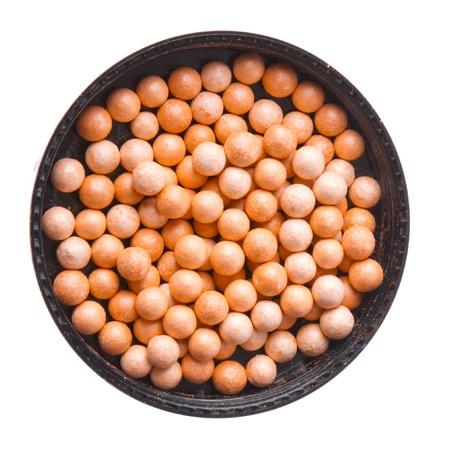 bronzing pearls isolated on white background photo