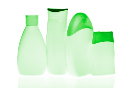 set of cosmetic bottles isolated on white background photo
