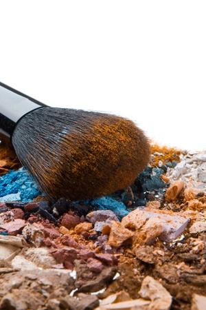 crushed eyeshadows with brush isolated on white background Stock Photo - 13815267