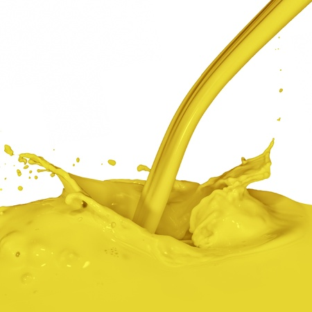 yellow paint splashing isolated on white photo