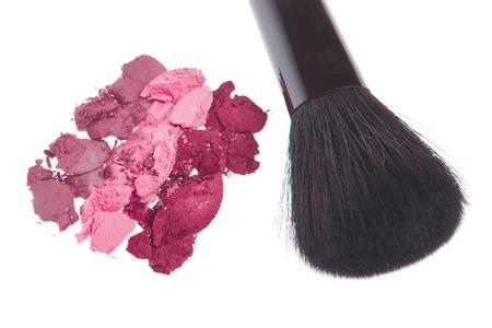 cream eyeshadows with brush isolated on white background photo