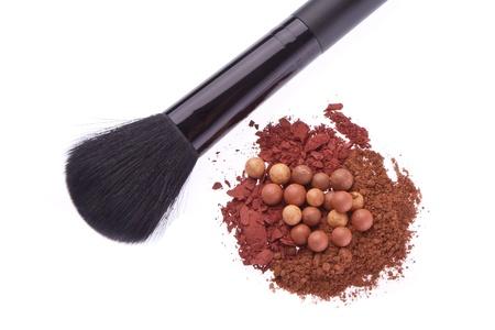 bronzing pearls and crushed eyeshadows with brush isolated on white background Stock Photo - 14036327