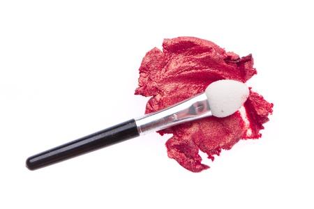 cream eyeshadow with brush isolated on white background photo