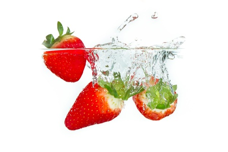 fresh strawberry dropped into water with splash on white backgrounds Stock Photo - 14400493