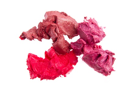 smudged lipsticks isolated on white background photo